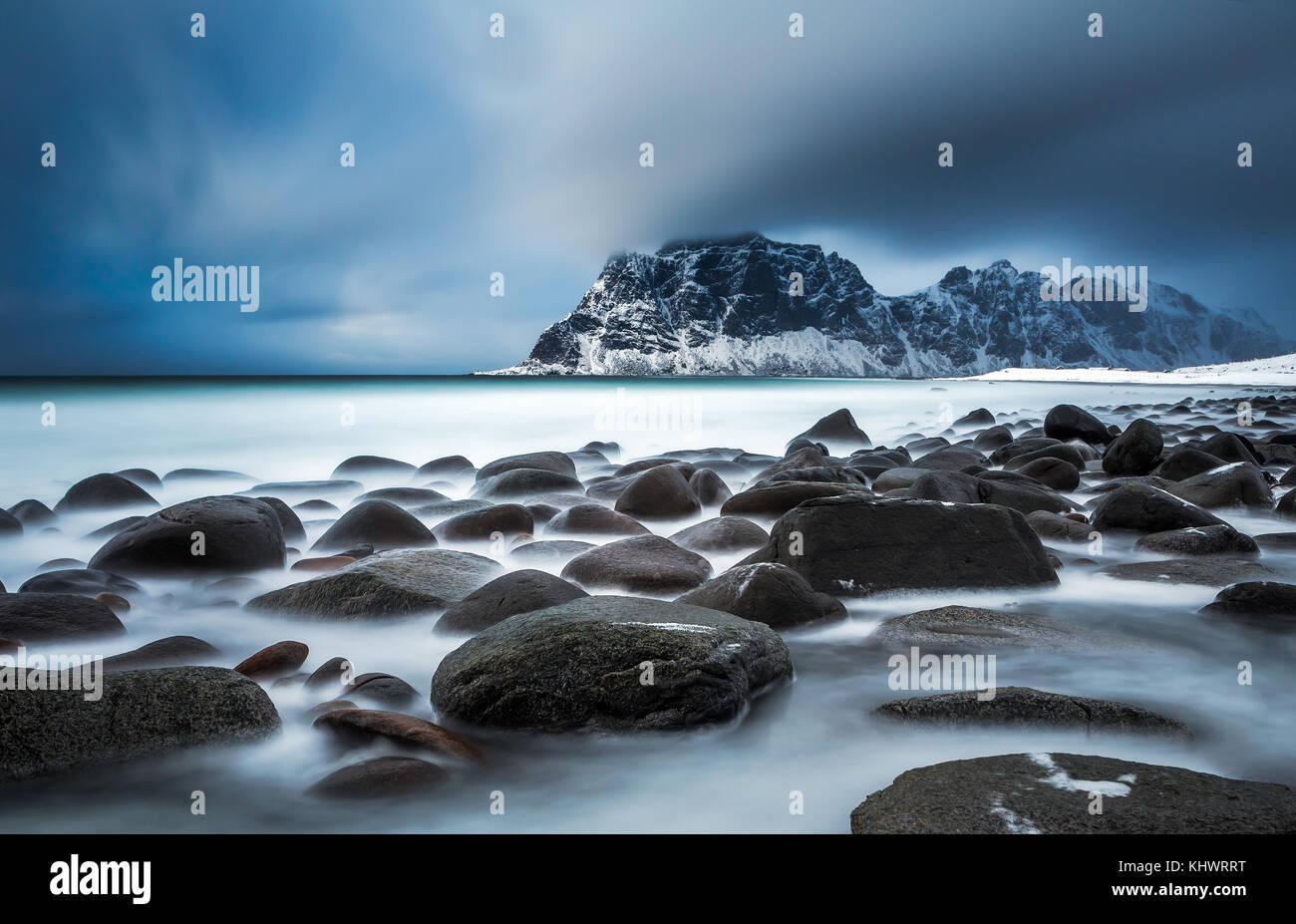 Rocky shore of Uttakleiv beach in winter, Vestvagoy, Lofoten Islands, Norway - Stock Image
