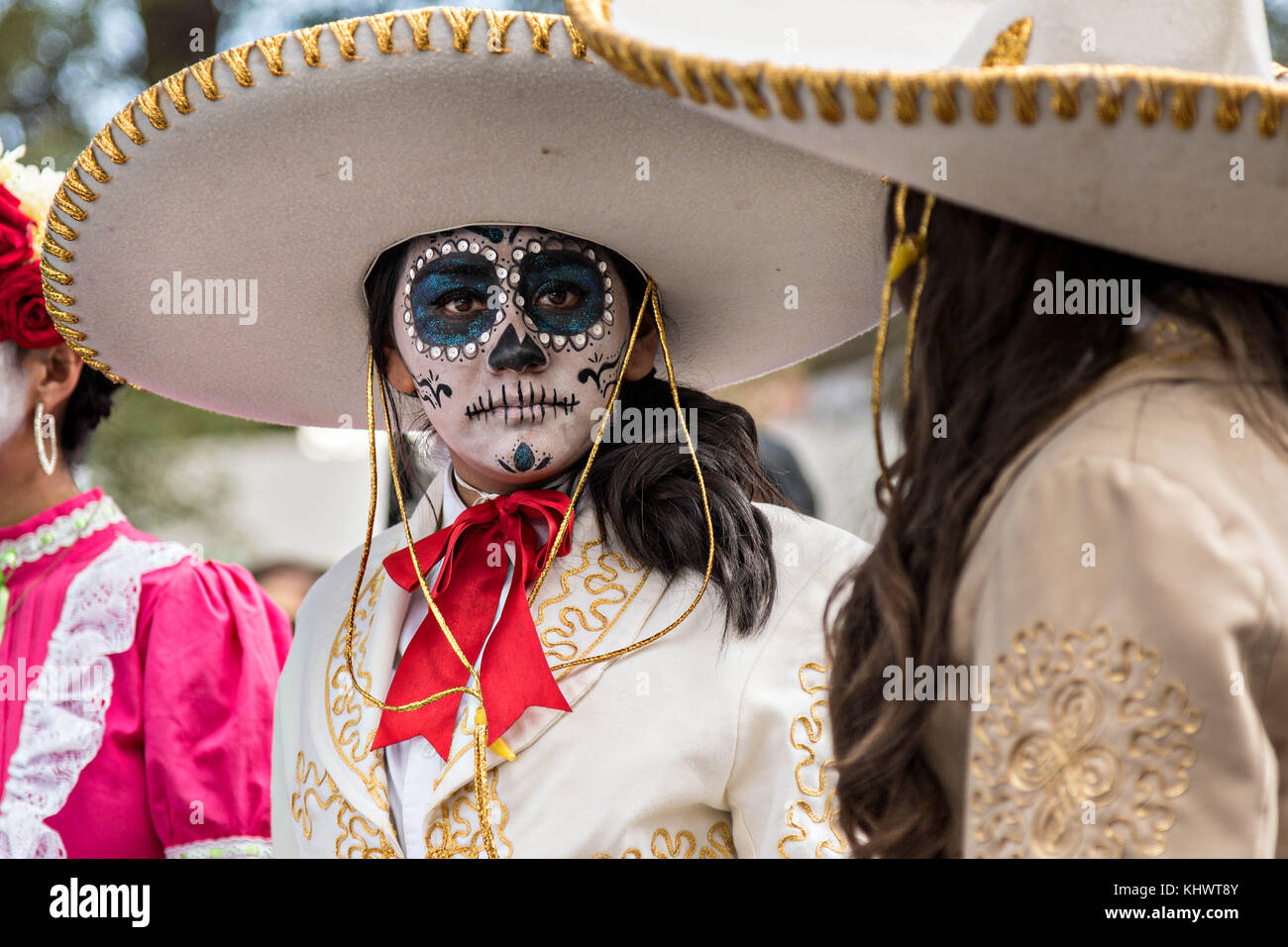 A Young Woman Dressed In La Calavera Catrina Costume During
