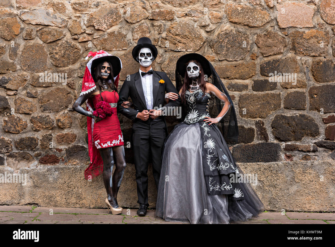 Mexican teens dressed in La Calavera Catrina and Dapper Skeleton costumes for the Day of the Dead or Día de - Stock Image