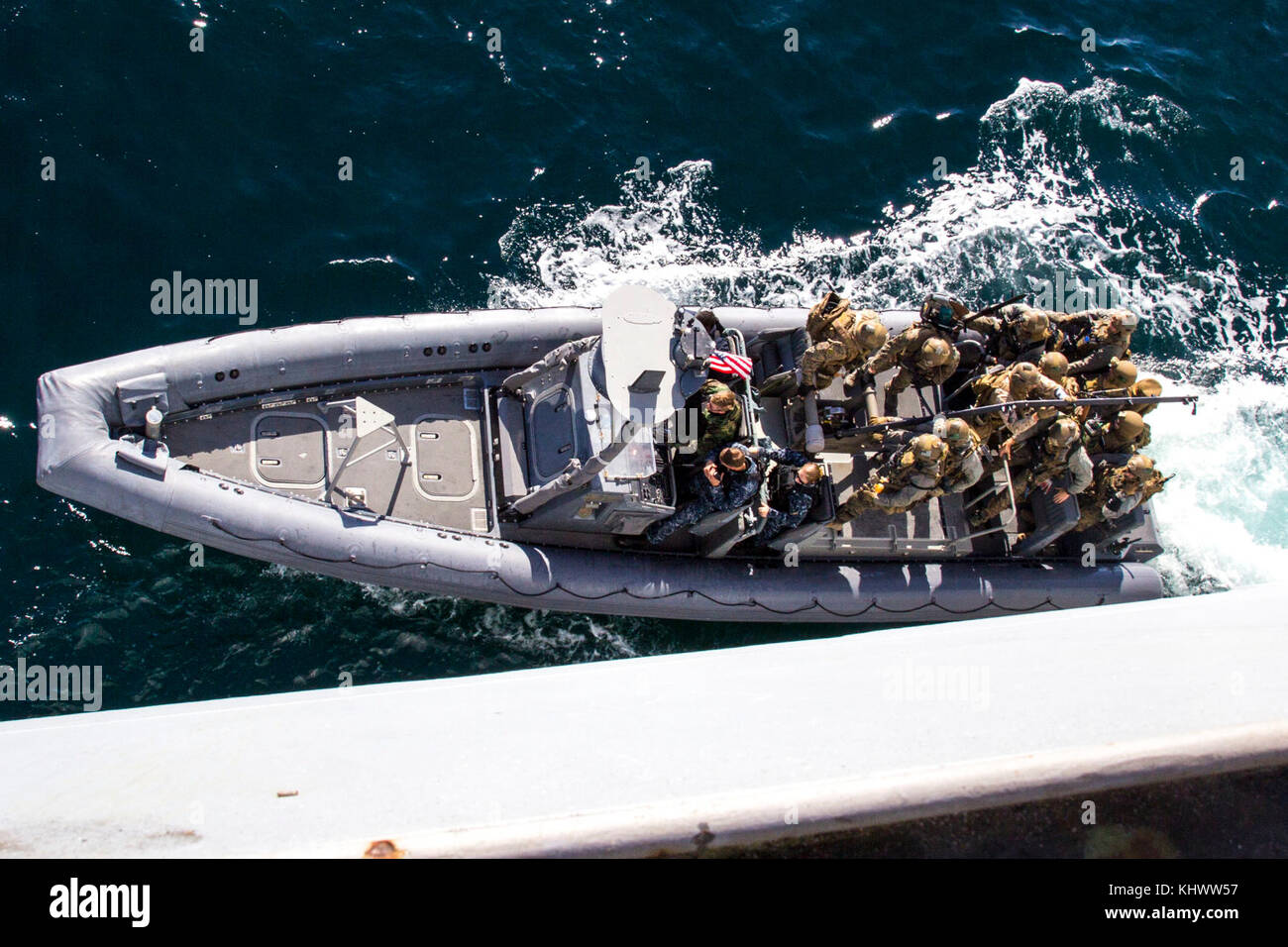 U.S. Marines with the Maritime Raid Force (MRF), 26th Marine Expeditionary Unit (MEU) board a Rigid Hulled Inflatable Stock Photo