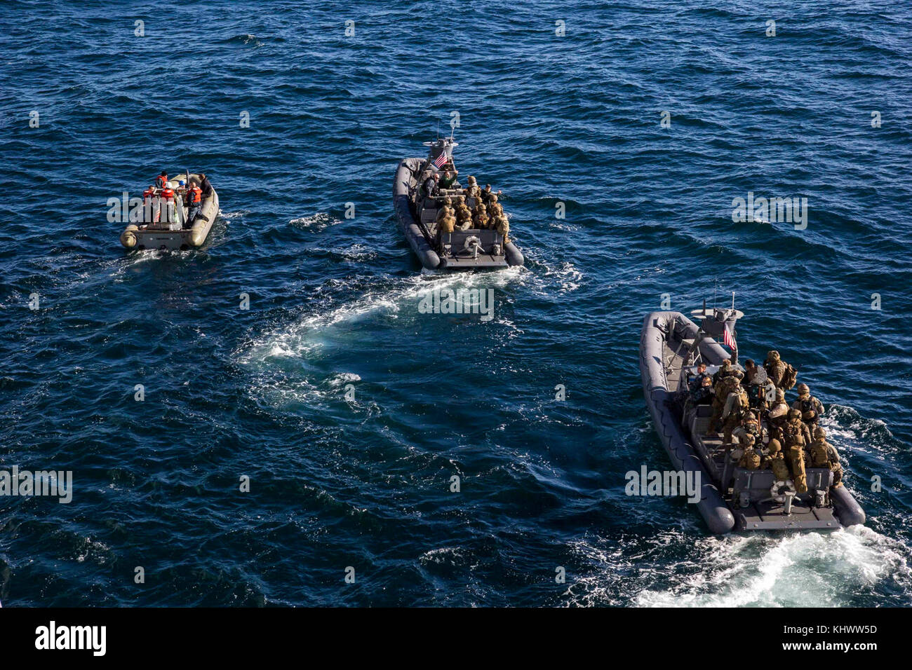 U.S. Marines with the Maritime Raid Force (MRF), 26th Marine Expeditionary Unit (MEU) embark on a visit, board, Stock Photo