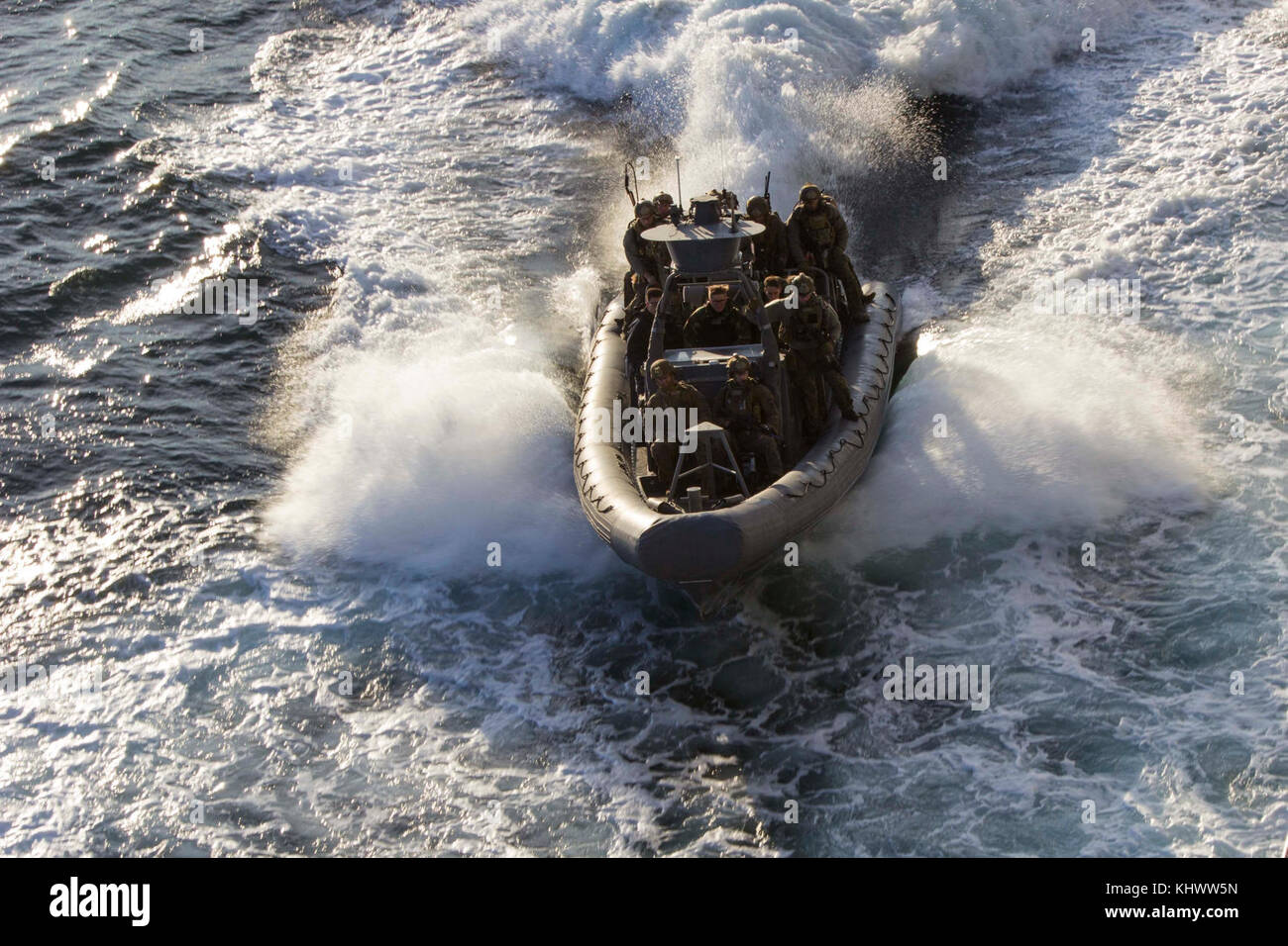 U.S. Marines with the Maritime Raid Force (MRF), 26th Marine Expeditionary Unit (MEU), approach the amphibious transport Stock Photo