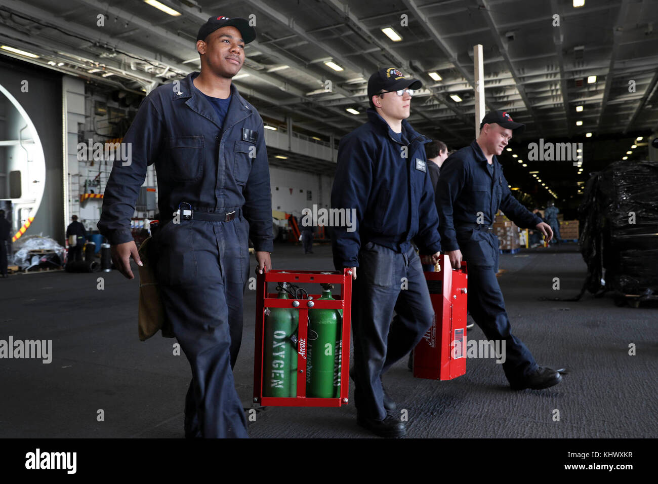 NORFOLK (Nov. 14, 2017) Sailors transport liquid oxygen in the hangar bay aboard the Nimitz-class aircraft carrier - Stock Image