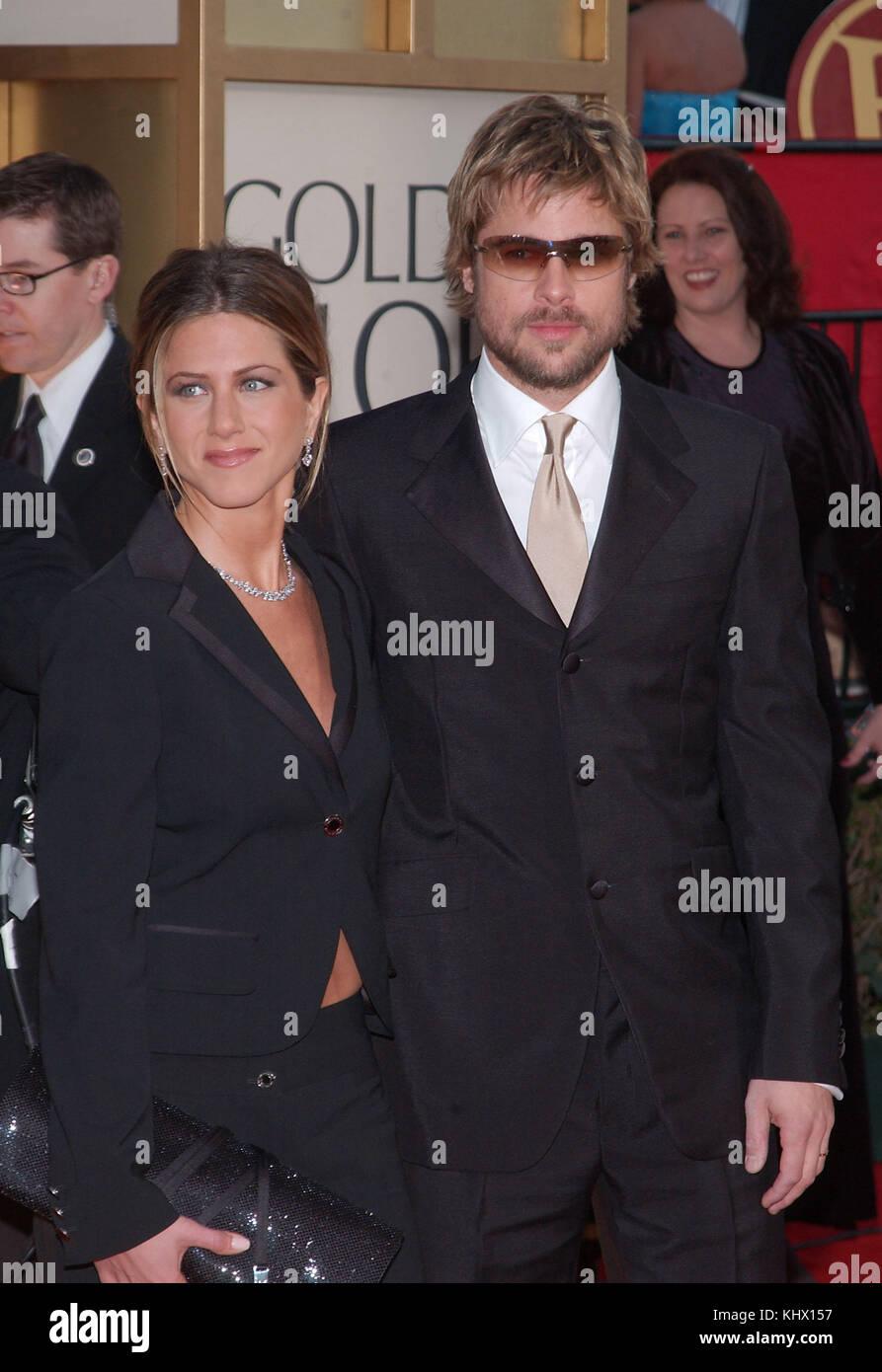 Jennifer Aniston and husband Brad Pitt arrive at The 59th