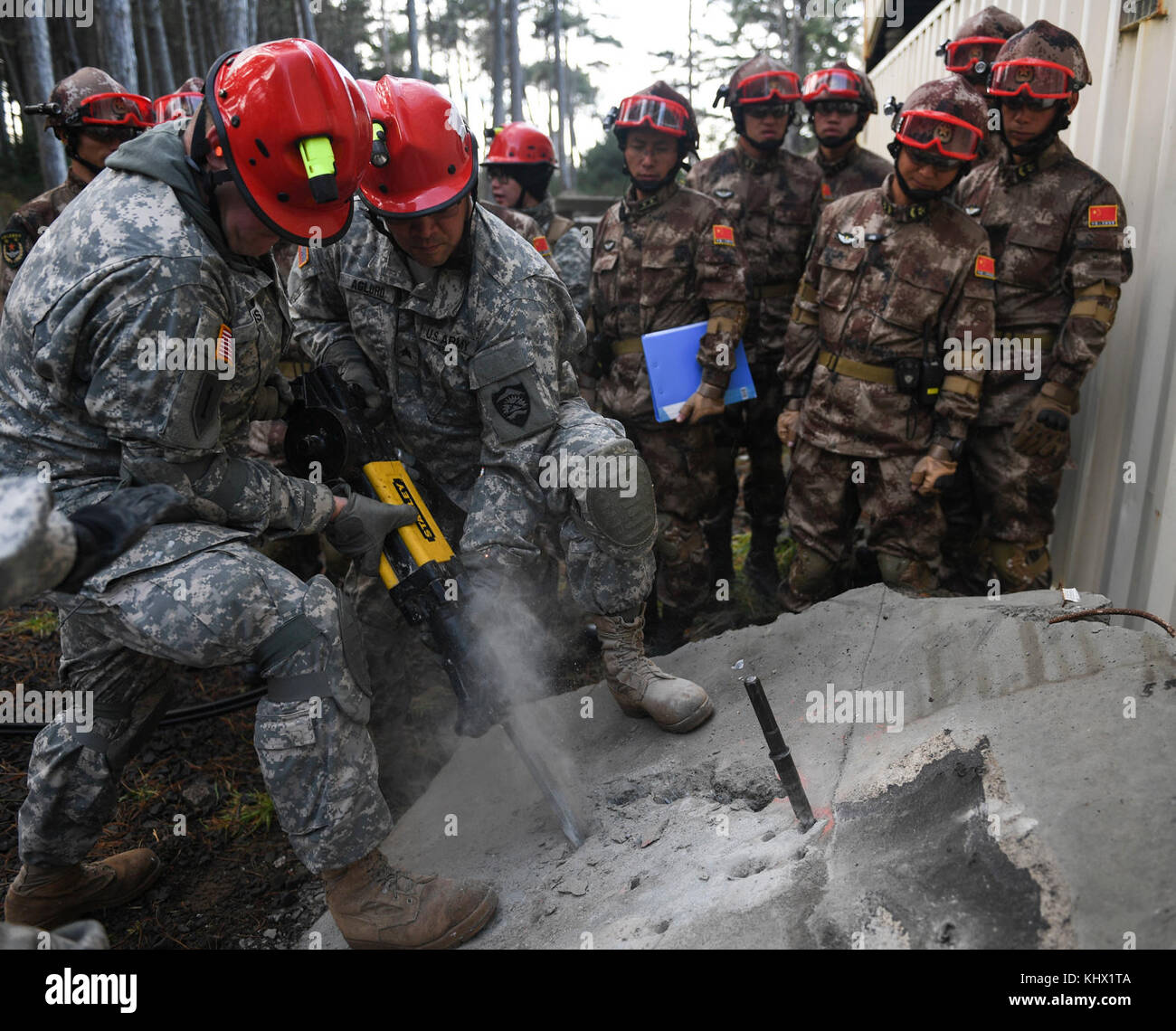 Participants hammer into concrete during the 2017 U.S. – China Disaster Management Exchange at Camp Rilea, Ore., - Stock Image
