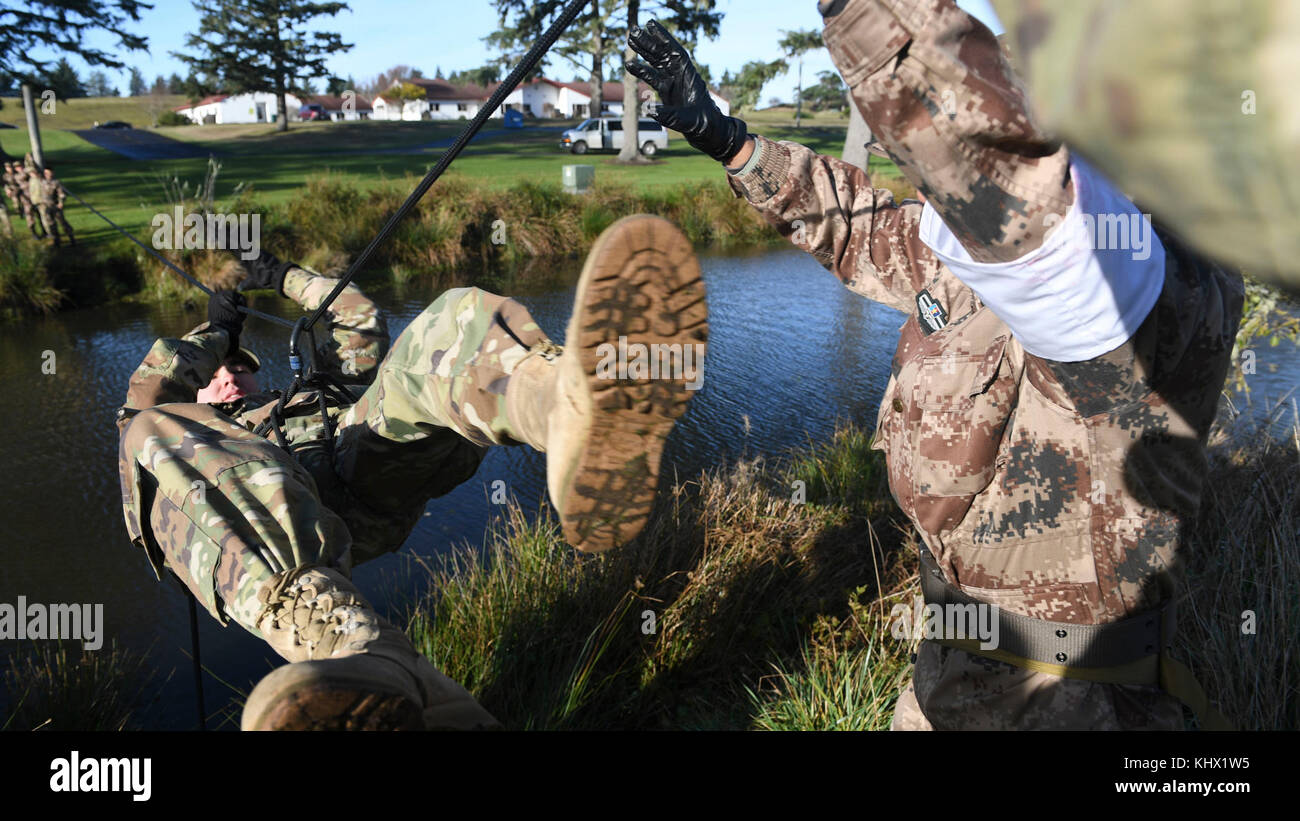 Participants use a one-rope bridge during the 2017 U.S. – China Disaster Management Exchange at Camp Rilea, Ore., - Stock Image
