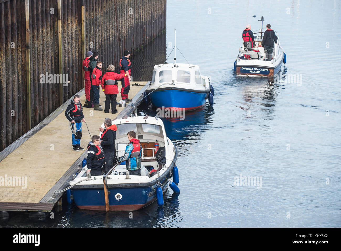 Cornwall Sea Cadets boarding small motor boats in preparation for a training exercise Falmouth Cornwall UK - Stock Image