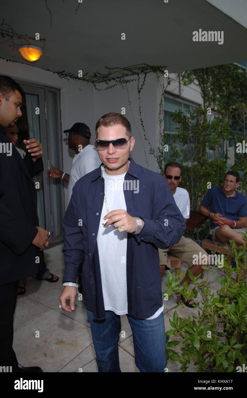 MIAMI, FL - JUNE 24: Scott Storch, a meerkat wearing sunglasses