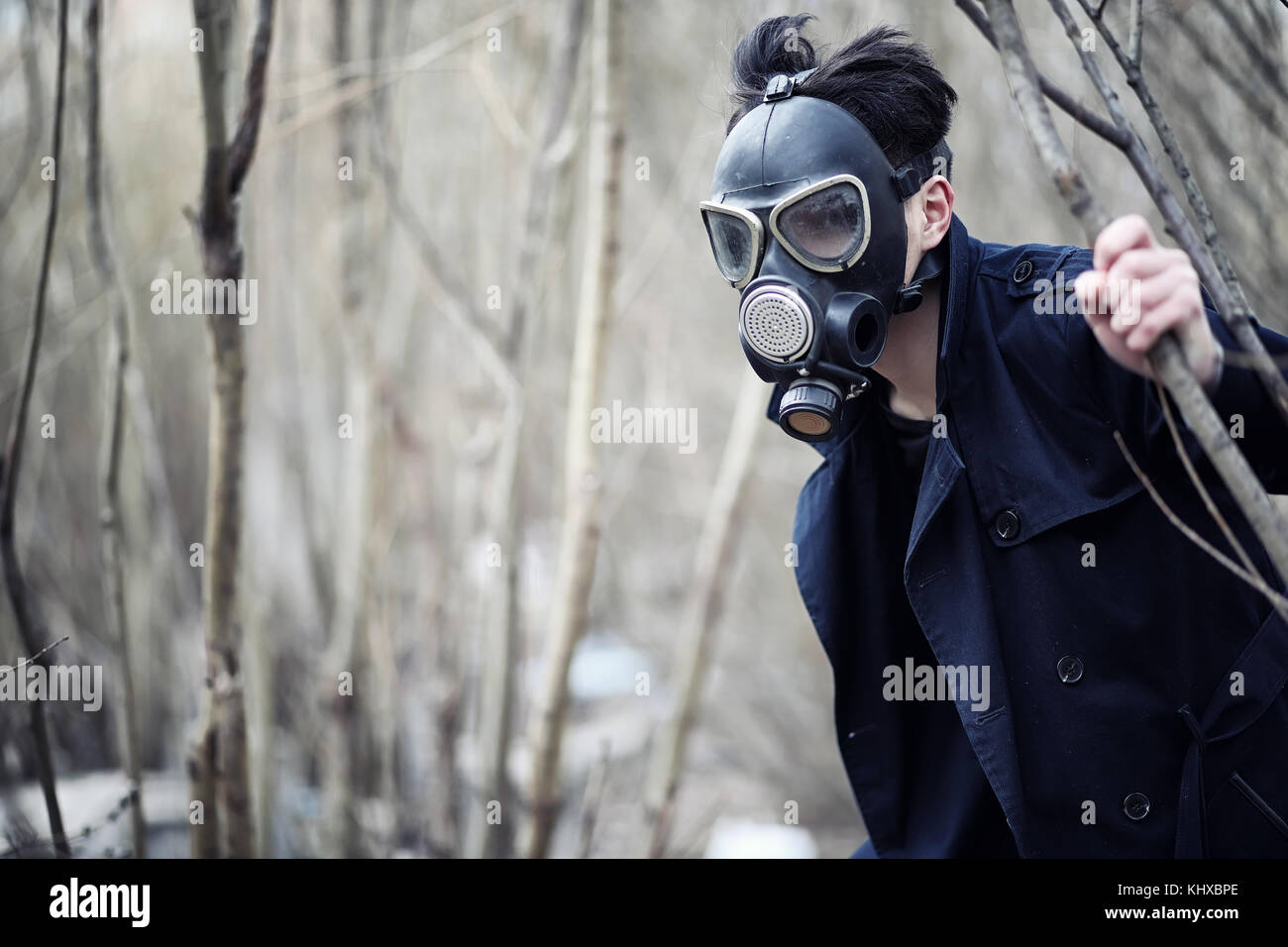The guy in the coat and gas mask. Post-apocalyptic portrait of A - Stock Image