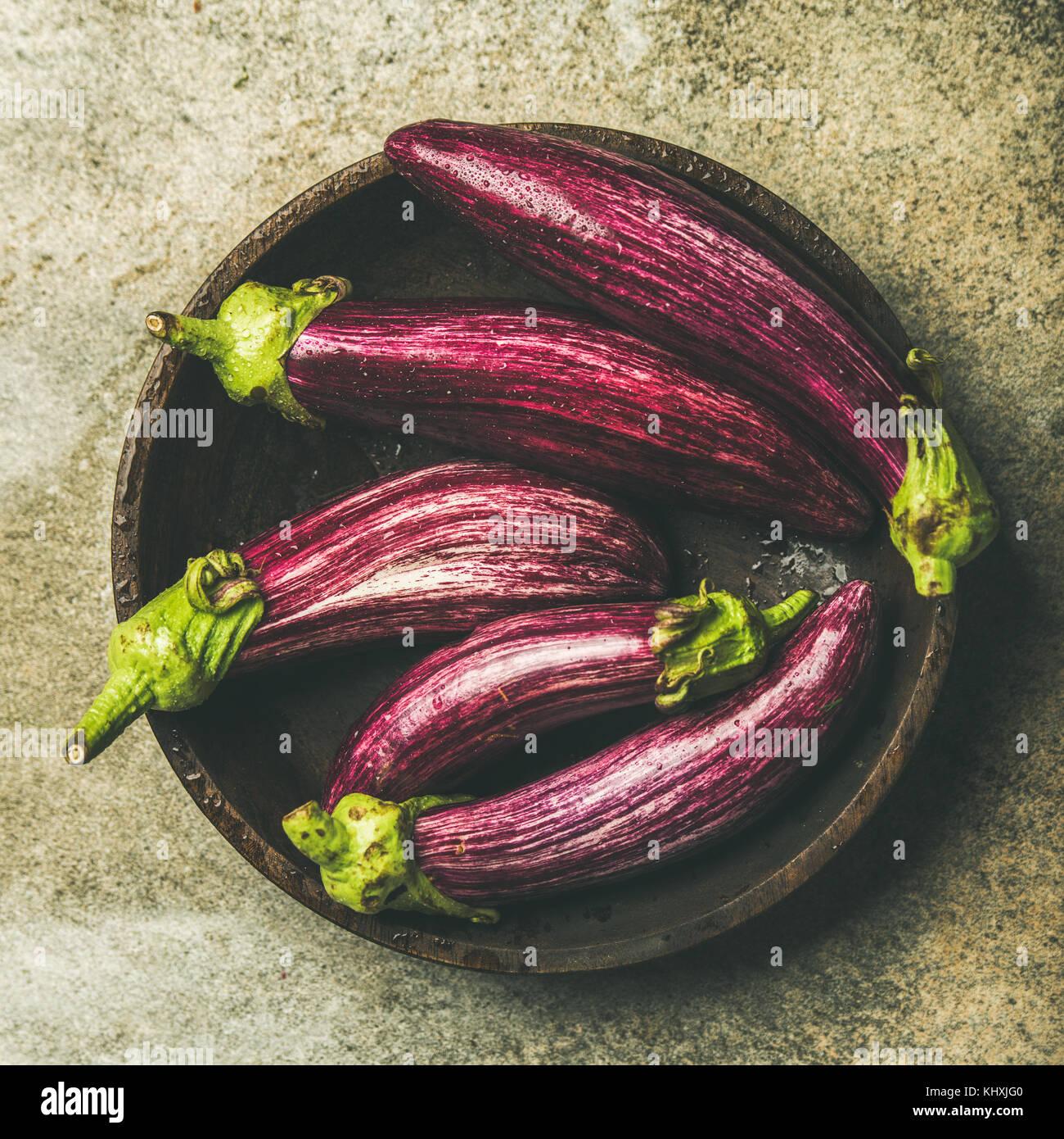 Flat-lay of fresh raw Fall harvest purple eggplants, square crop - Stock Image