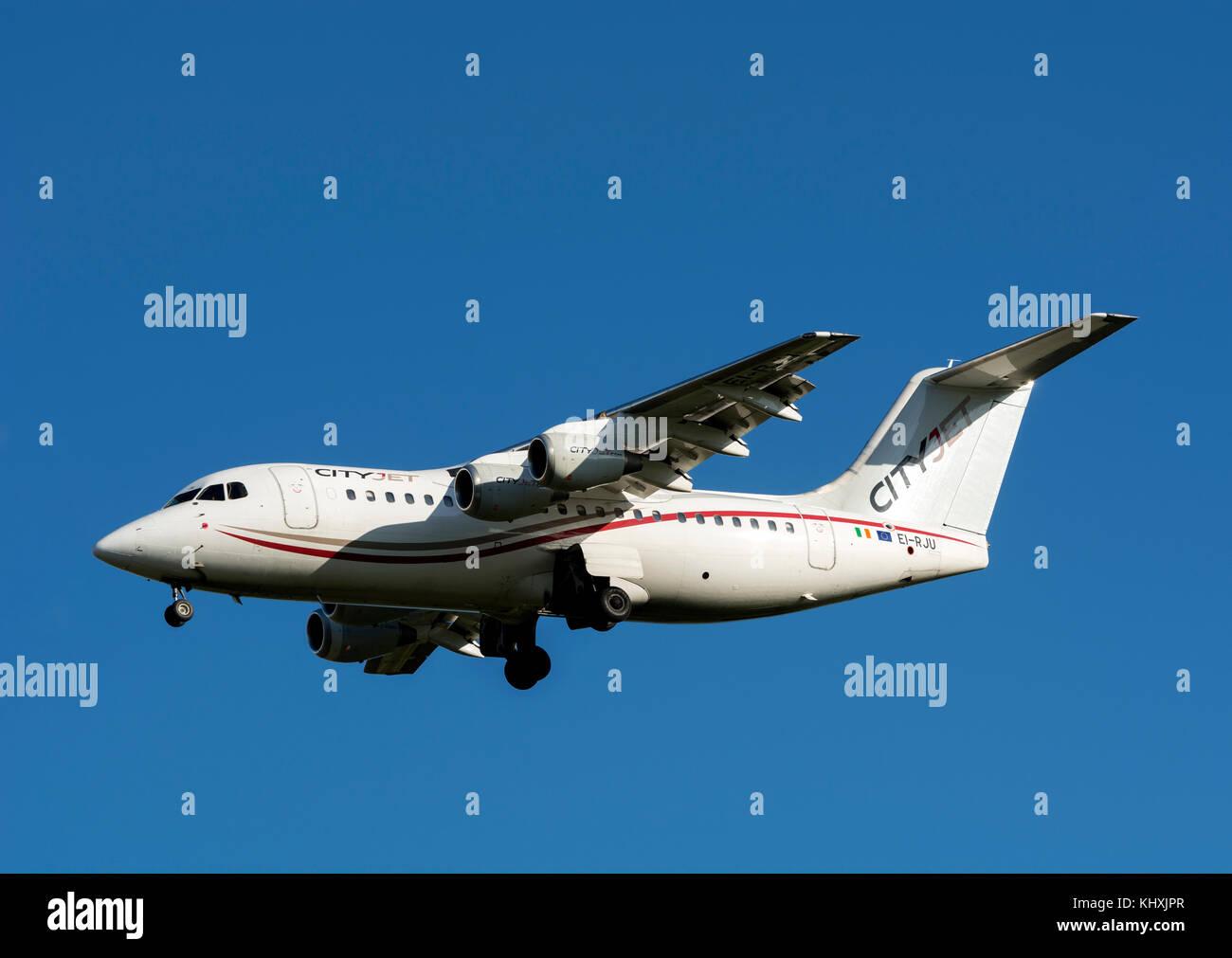 Cityjet Avro RJ85 landing at Birmingham Airport, UK (EI-RJU) - Stock Image