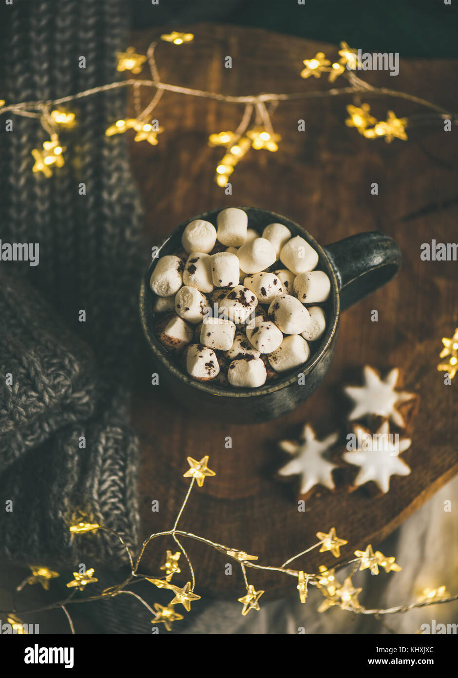 Christmas winter hot chocolate served with light garland, top view - Stock Image