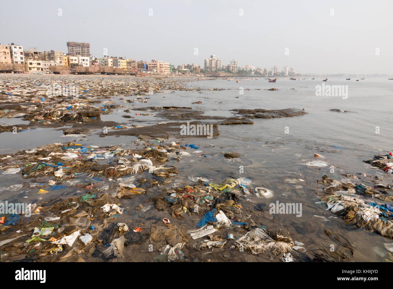 Plastic garbage and other rubbish covers Versova beach, Mumbai, India - Stock Image