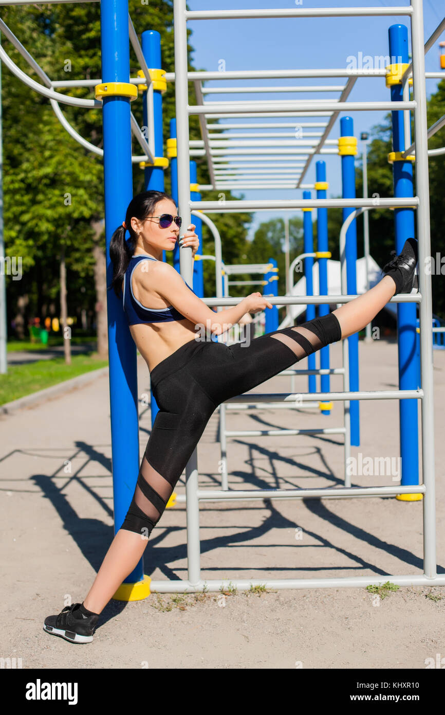 female trainer on sport playground - Stock Image