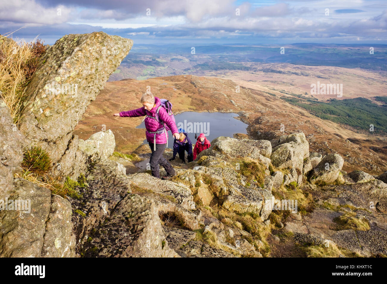 Hikers climbing on the Daear Ddu east ridge scramble on Carnedd Moel Siabod mountain in mountains of Snowdonia National - Stock Image