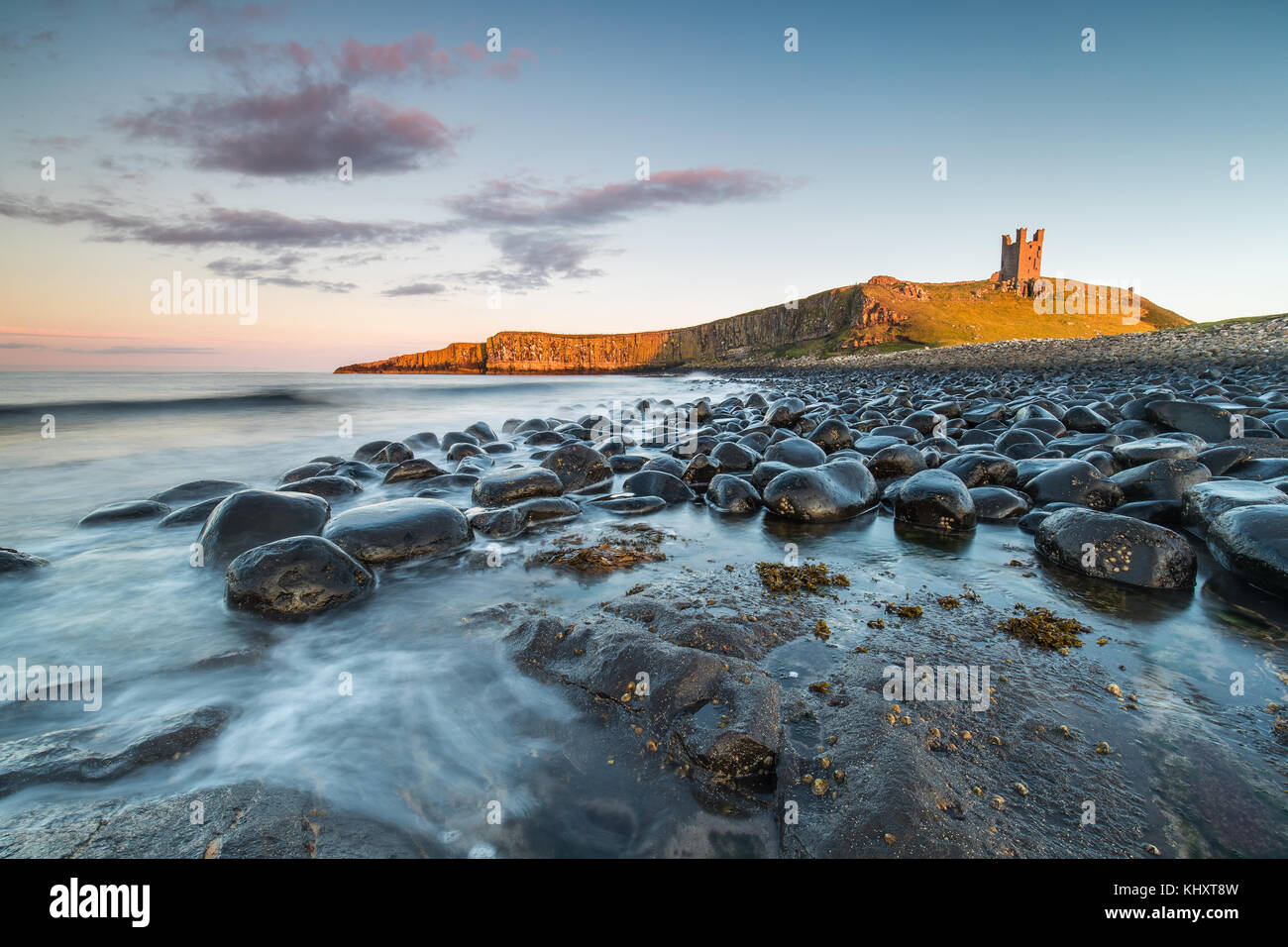 Dunstanburgh Castle looking from the North, the tide had been receading and was the perfect opportunity to take - Stock Image