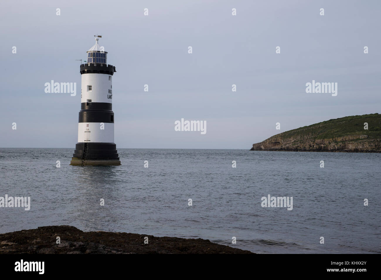 Penmon lighthouse, Trwyn Du Lighthouse between Black Point near Penmon and Ynys Seriol, or Puffin Island, at the - Stock Image