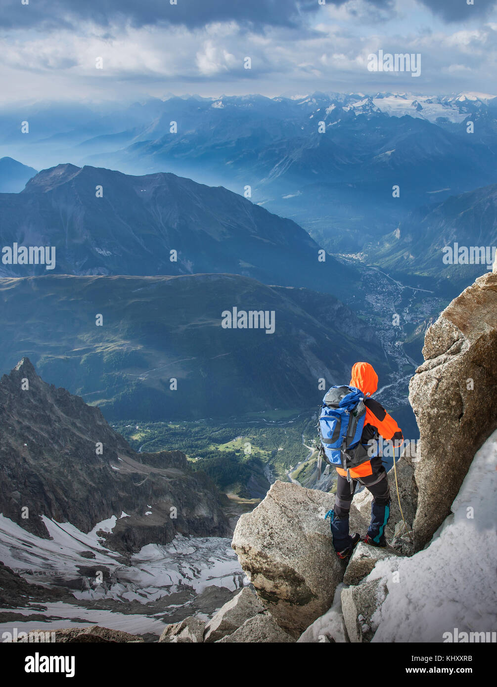 Mountain climber descending the Dent du Geant, in the Mont Blanc Massif, Courmayeur, Aosta Valley, Italy, Europe Stock Photo
