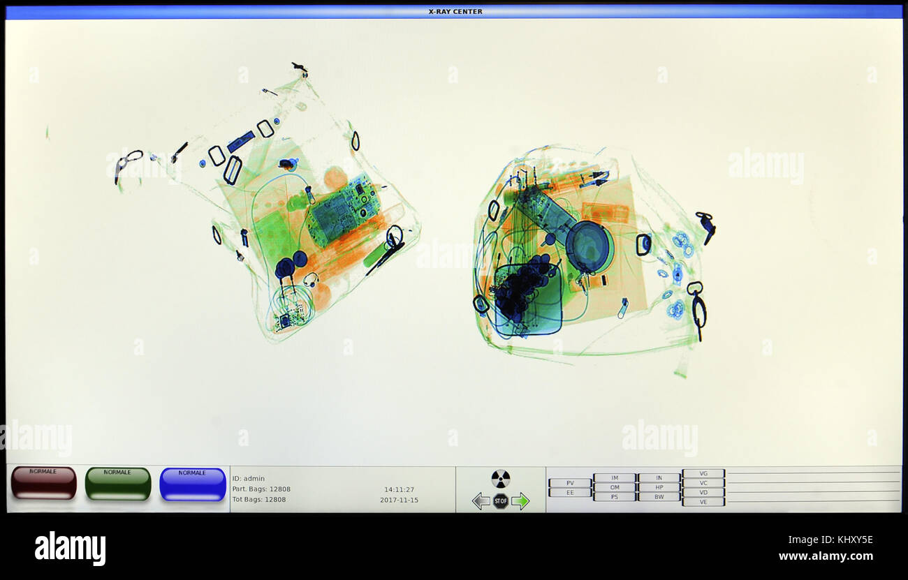 screenshot from an airport x-ray luggage security scanner - Stock Image