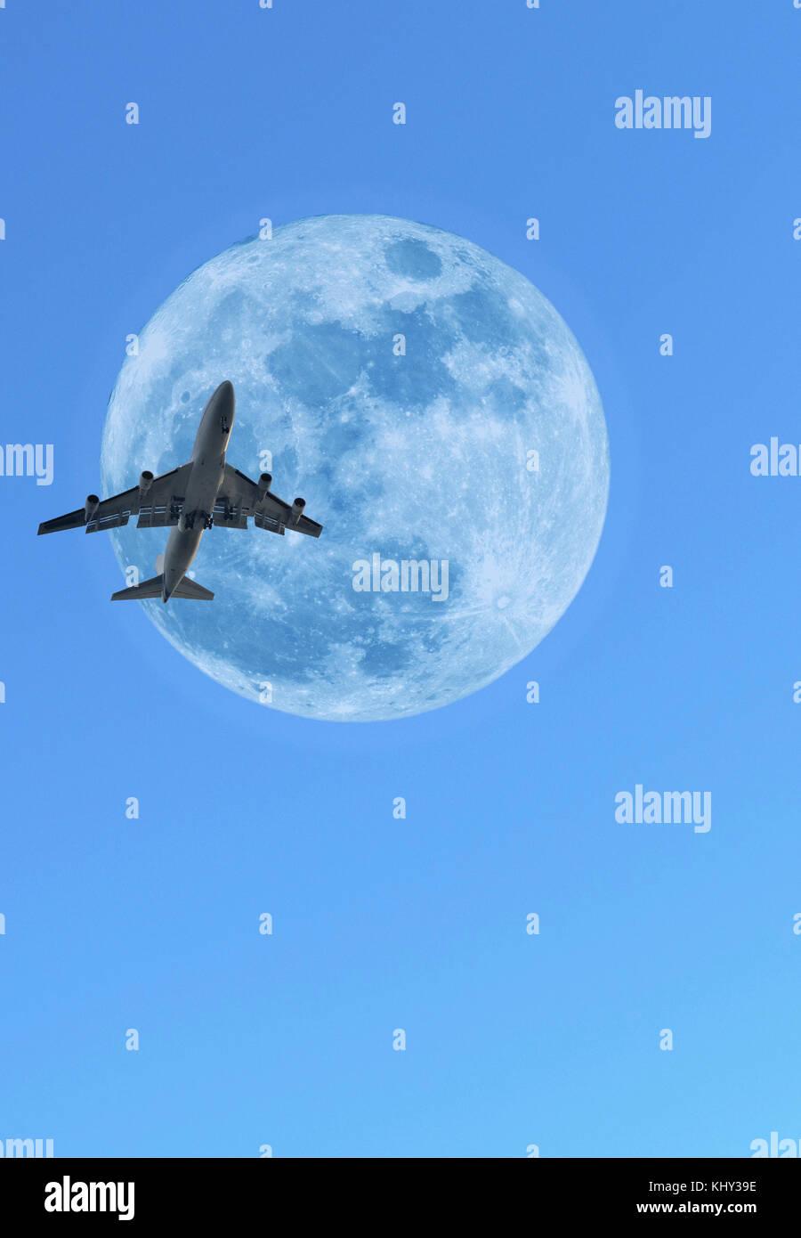 Jumbo jet aeroplane crossing daytime moon - Stock Image