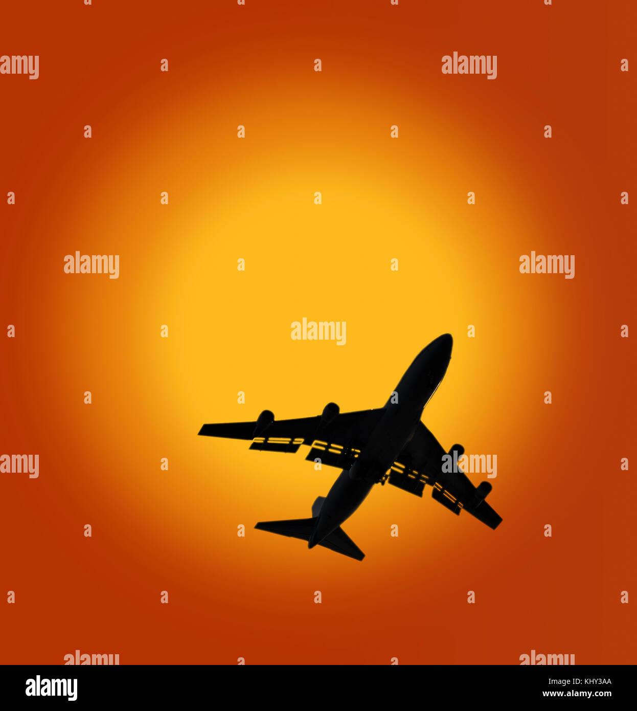 Jumbo jet boeing 747 crossing sun disc - Stock Image