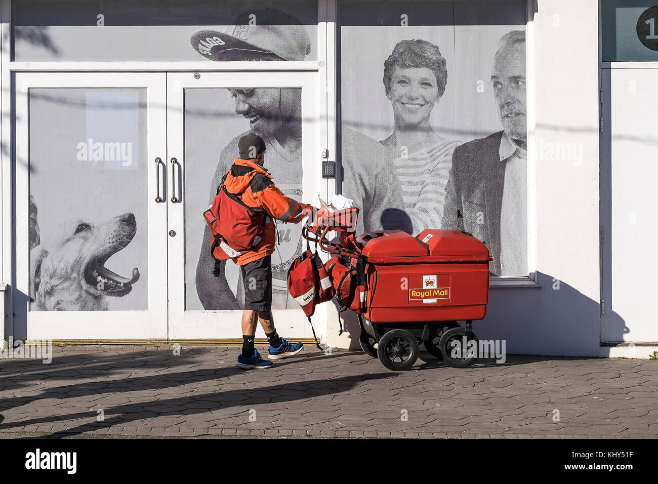 A Royal Mail postman postal worker. - Stock Image