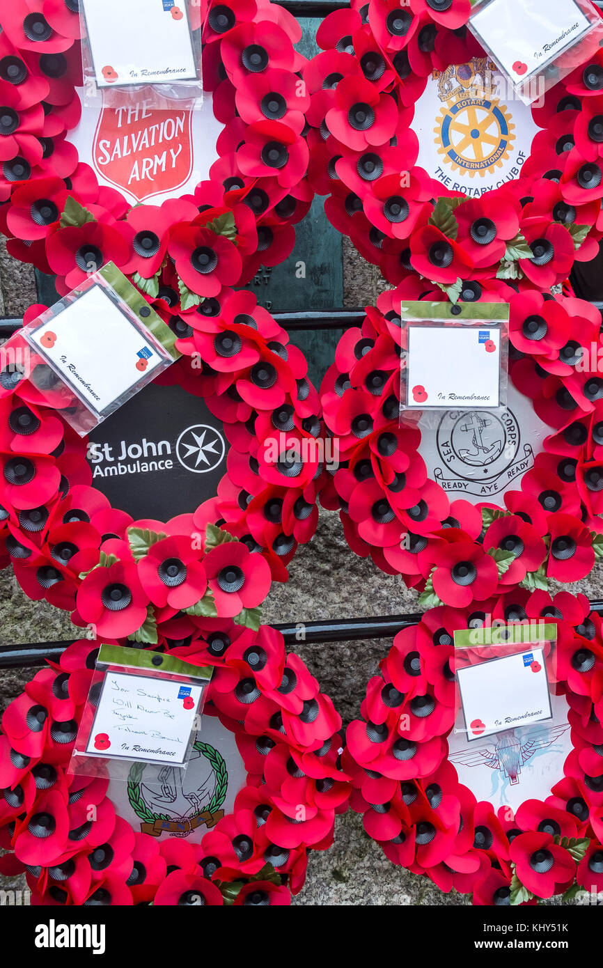 Poppy wreaths left at Truro Cenotaph in Cornwall. - Stock Image