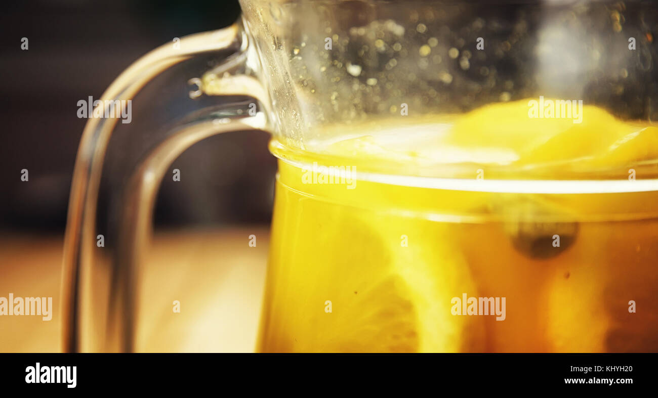 hot drink from oranges lemons ginger and cinnamon - Stock Image