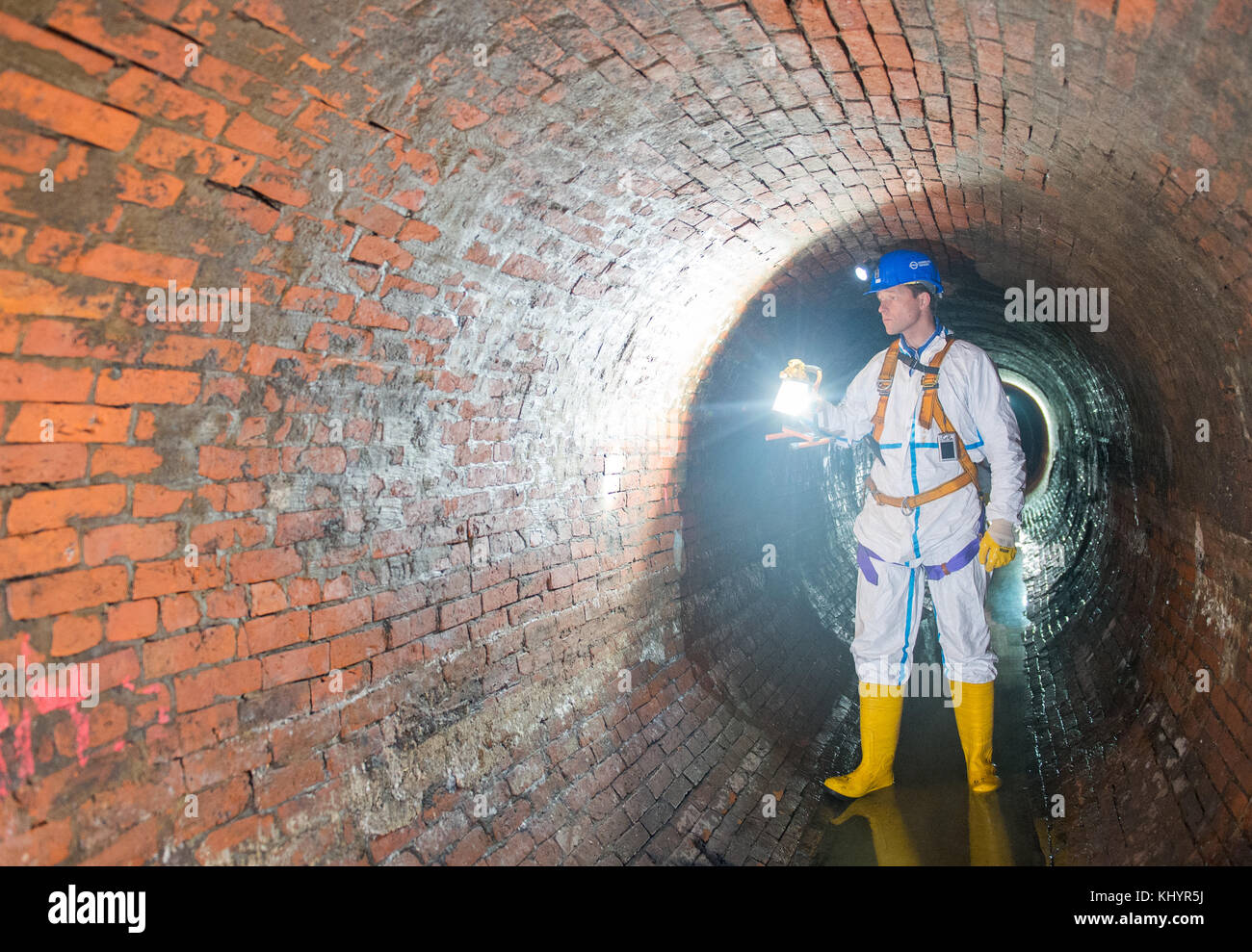 Oliver Harten of 'Hamburg Wasser' (Hamburg waterworks) checks a sewer that is being modernised during a - Stock Image