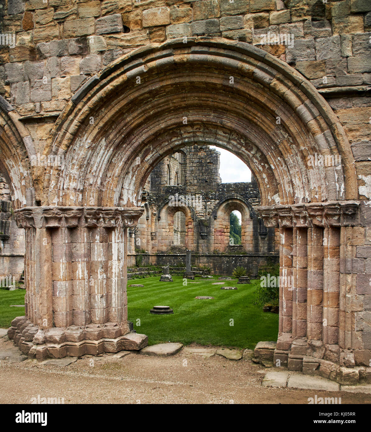 England, NorthYorkshire;Romanesque arch ; North Yorkshire the ruins of the 12th century Cistercian Abbey known as - Stock Image