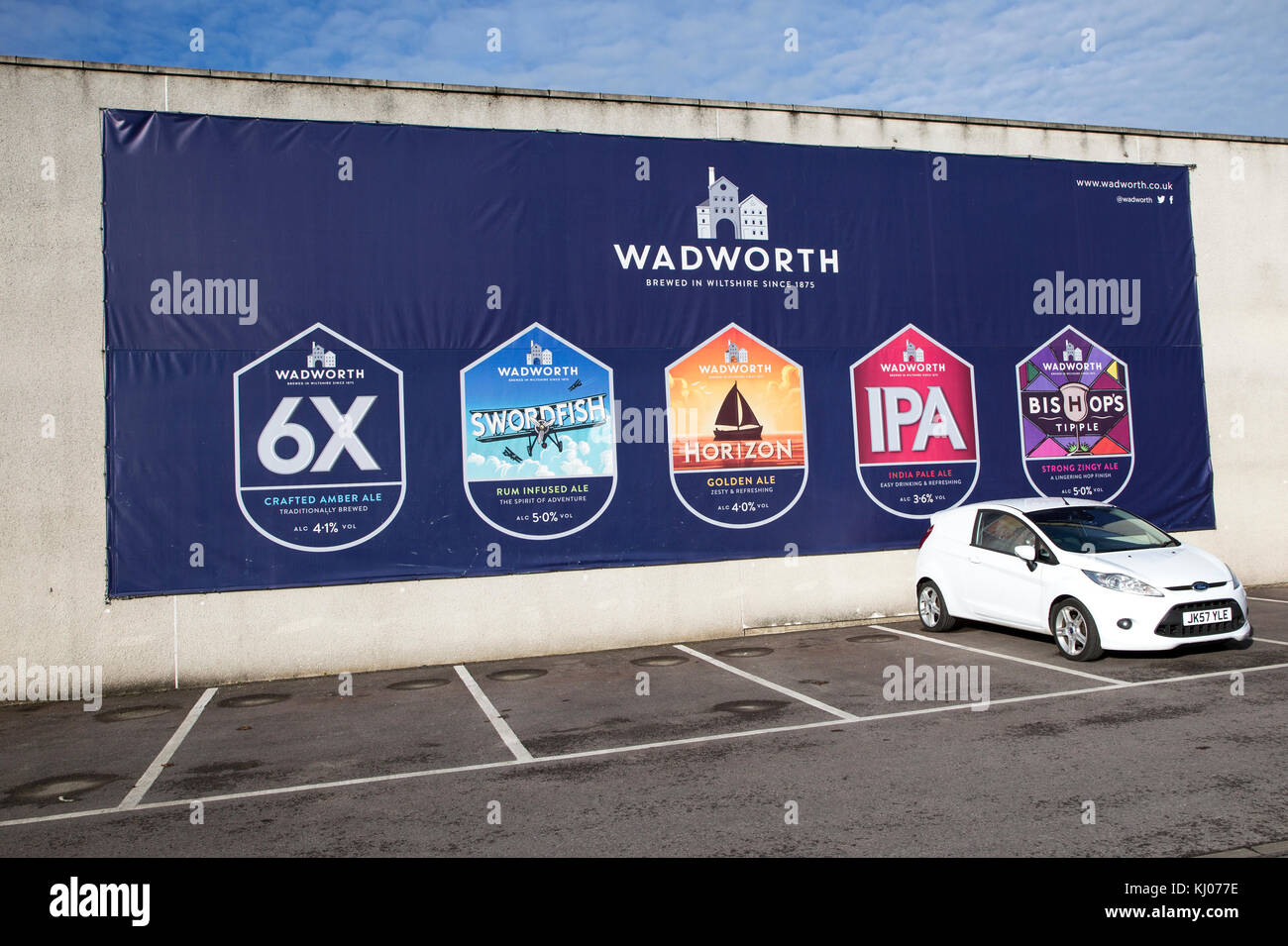 Billboard traditionally brewed beer advertising poster at Wadworth brewery, Devizes, Wiltshire, England, UK - Stock Image