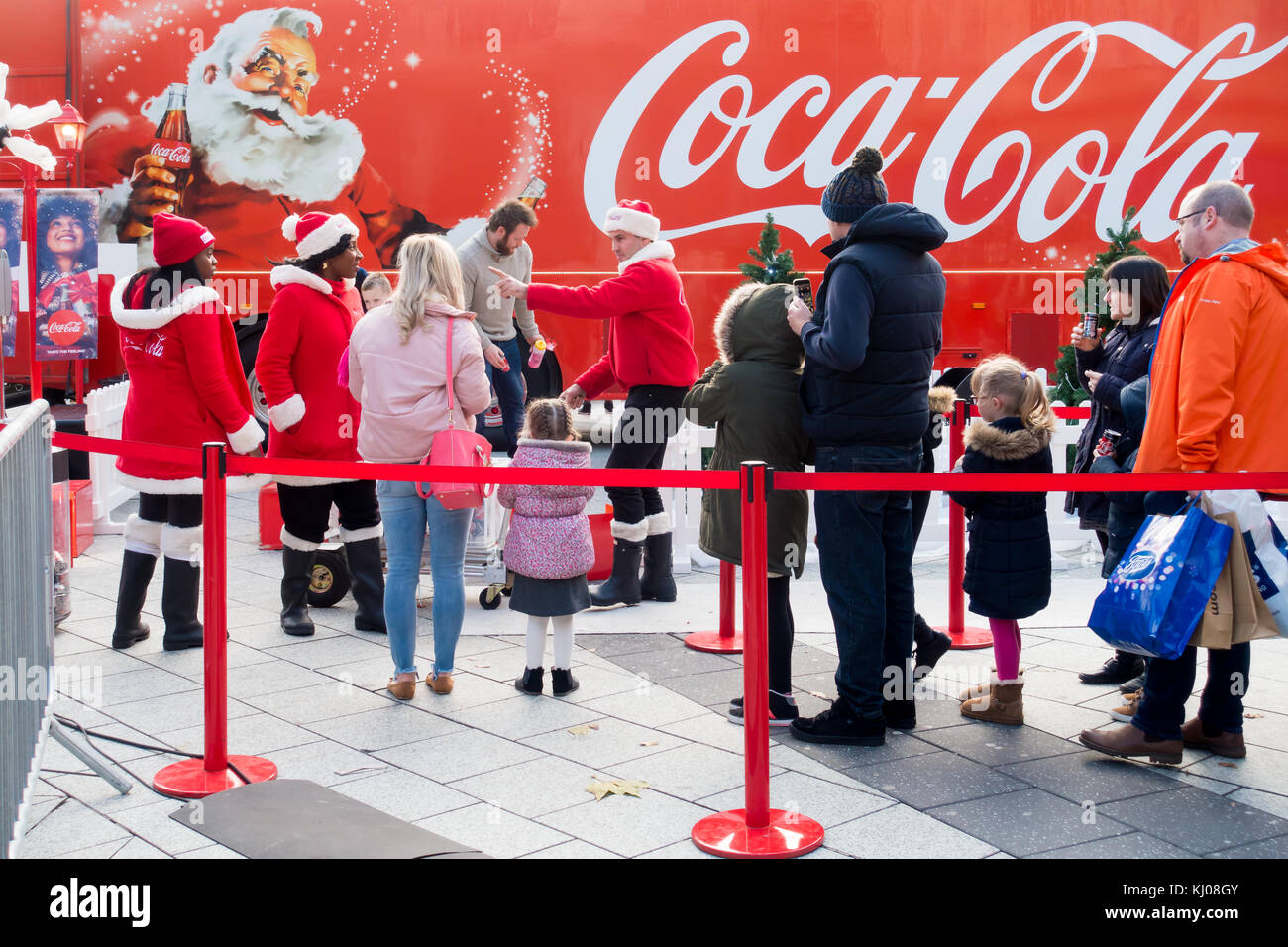 Cardiff, United Kingdom -  November 19, 2017: People are queueing in front of the Coca Cola Christmas truck in Cardiff - Stock Image