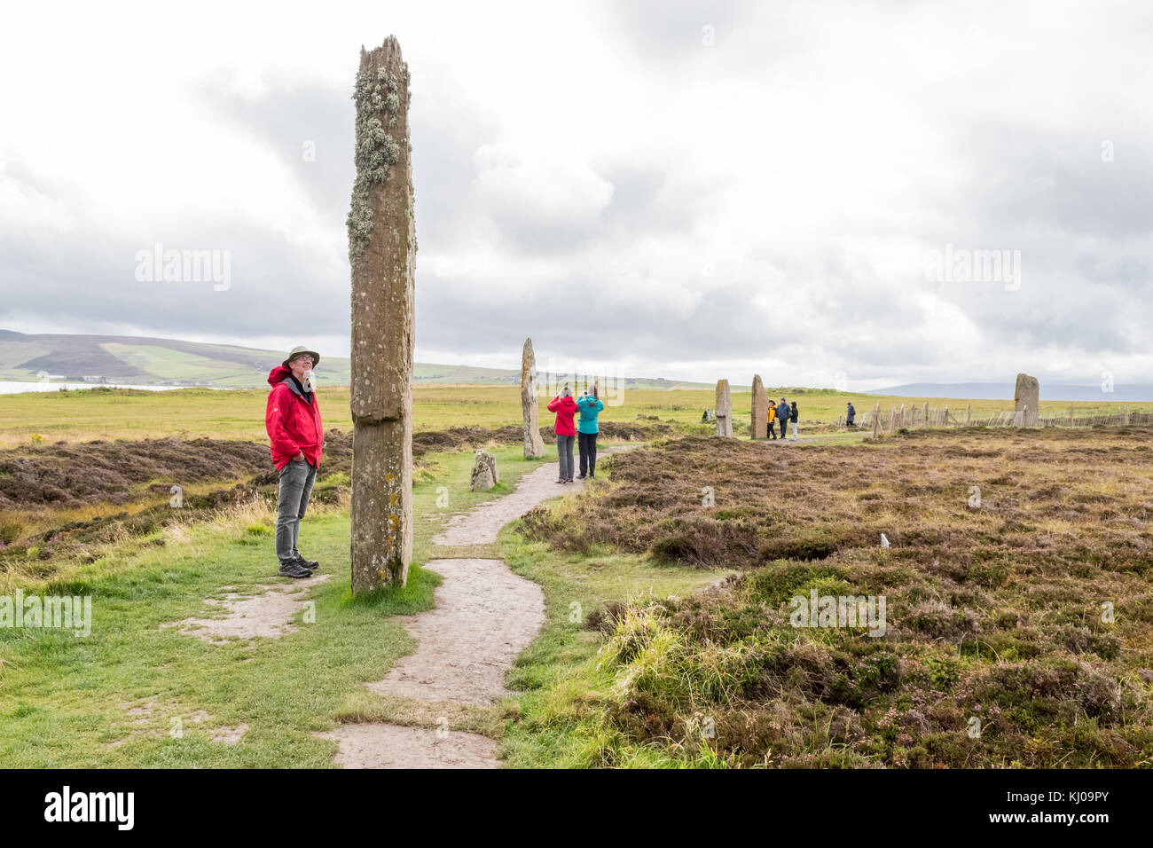 tourists at the Ring of Brodgar Neolithic henge and stone circle, Stromness, Mainland Orkney, Scotland, UK - Stock Image