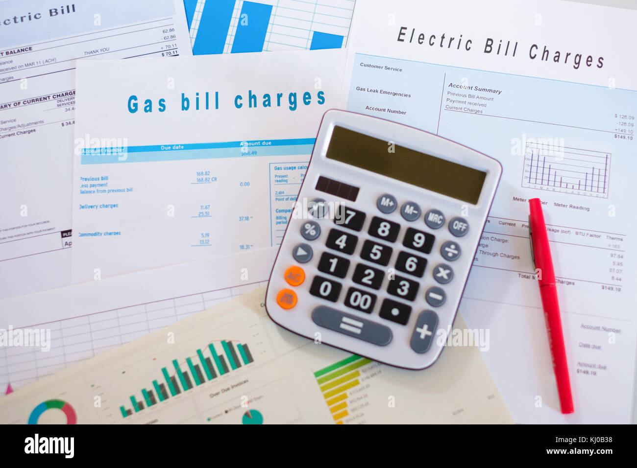 Energy efficiency concept with charges invoice documents on desk - Stock Image