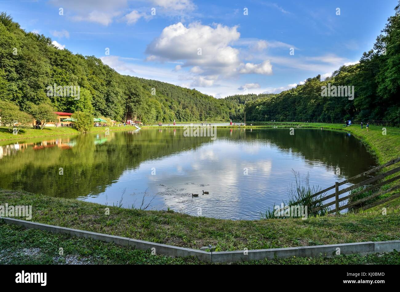 BEDKOWSKA VALLEY, POLAND - AUGUST 13, 2017: Tourists on the pond in the Bedkowska Valley, Poland. - Stock Image