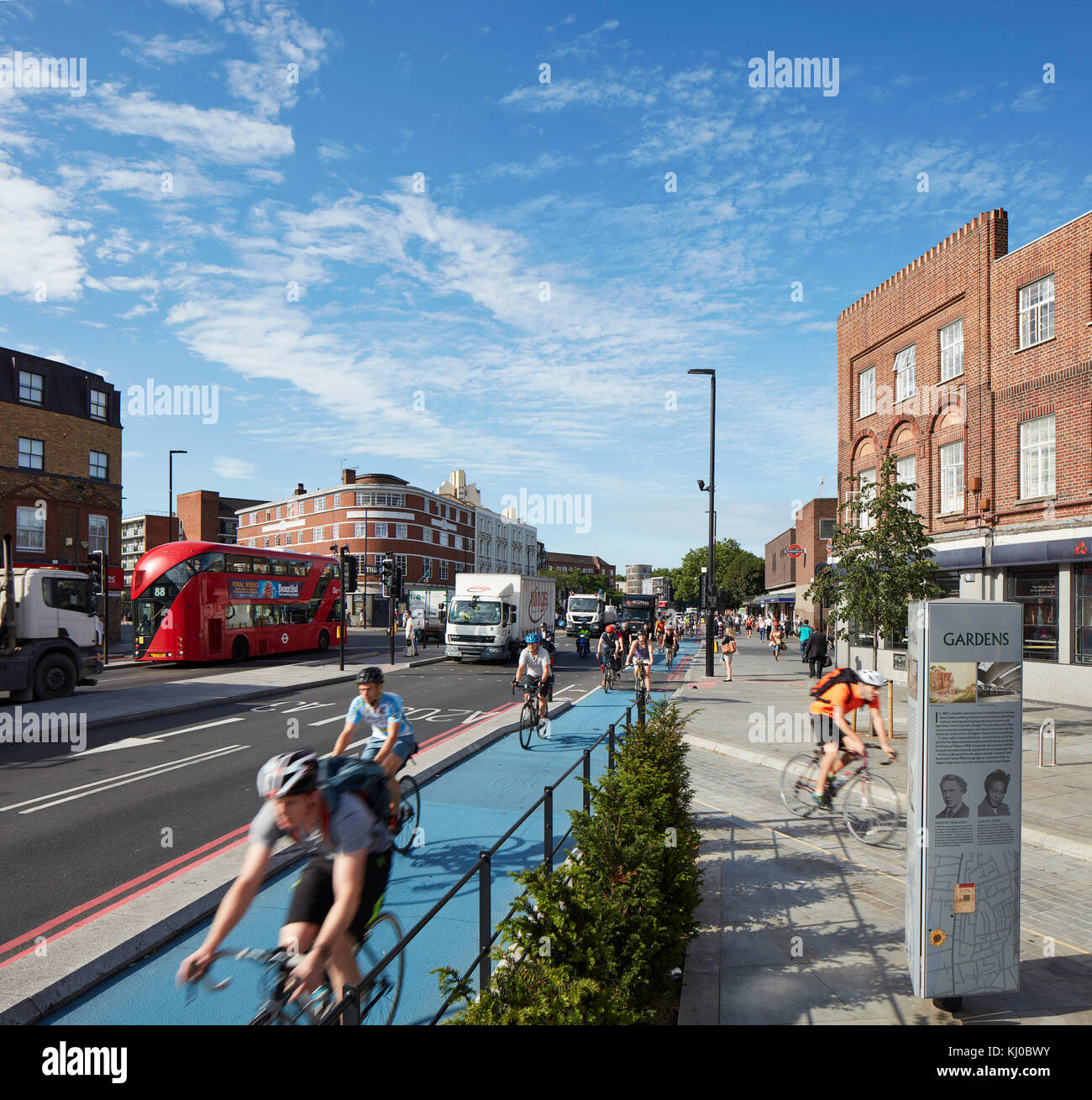 Intersection with new bicycle lane and morning traffic. Stockwell Framework Masterplan, London, United Kingdom. - Stock Image
