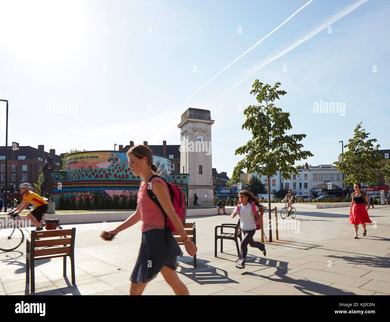 Stockwell War Memorial with bicycle lane and pedestrians. Stockwell Framework Masterplan, London, United Kingdom. - Stock Image