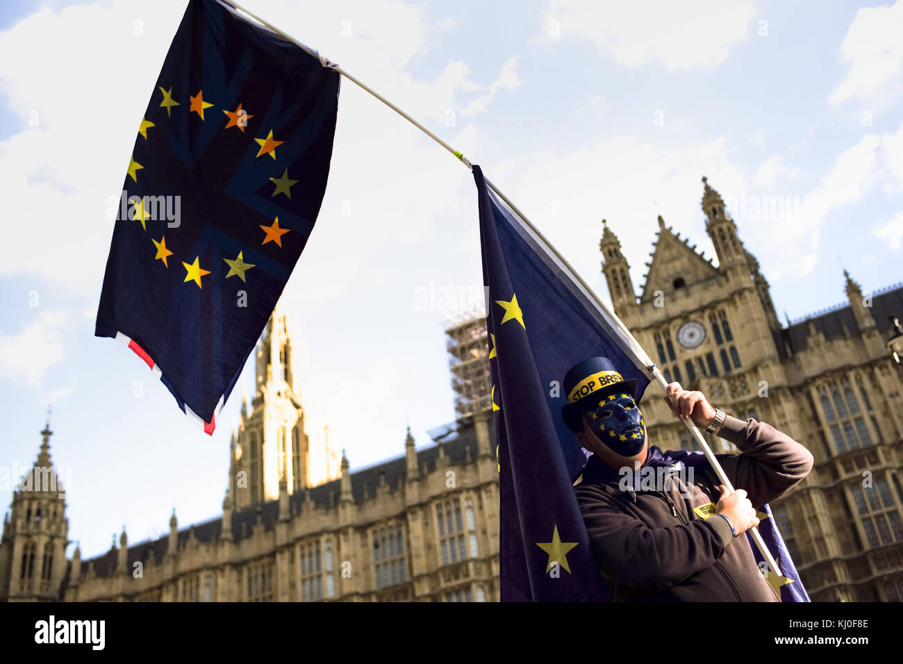A lone pro European union protester stands outside the Houses of parliament in demonstration to the outcome of the - Stock Image
