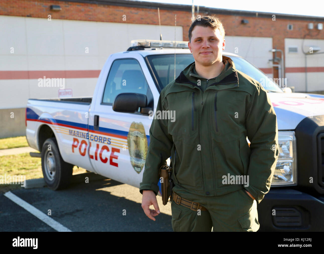 MARINE CORPS BASE QUANTICO, Virginia – Sgt. Ty Brautigam poses for a photograph in front of the Provost Marshal - Stock Image