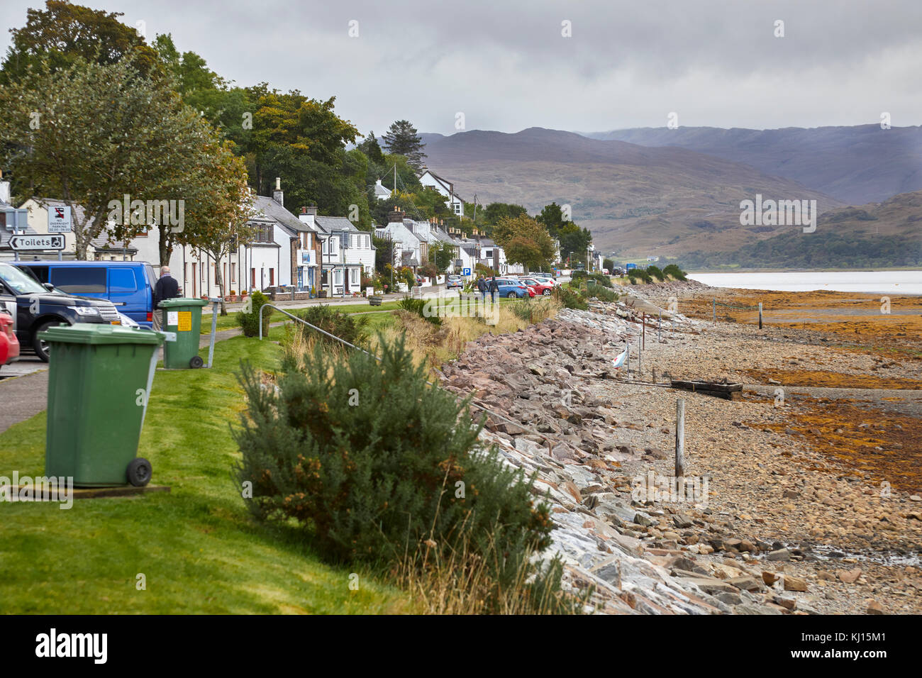 Part of the North Coast 500, the A896 looking north east along the loch front of Lochcarron with the shoreline of - Stock Image