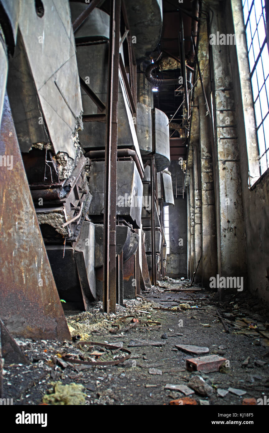 The interior of an old ruined factory. Forgotten foundry furnace. - Stock Image