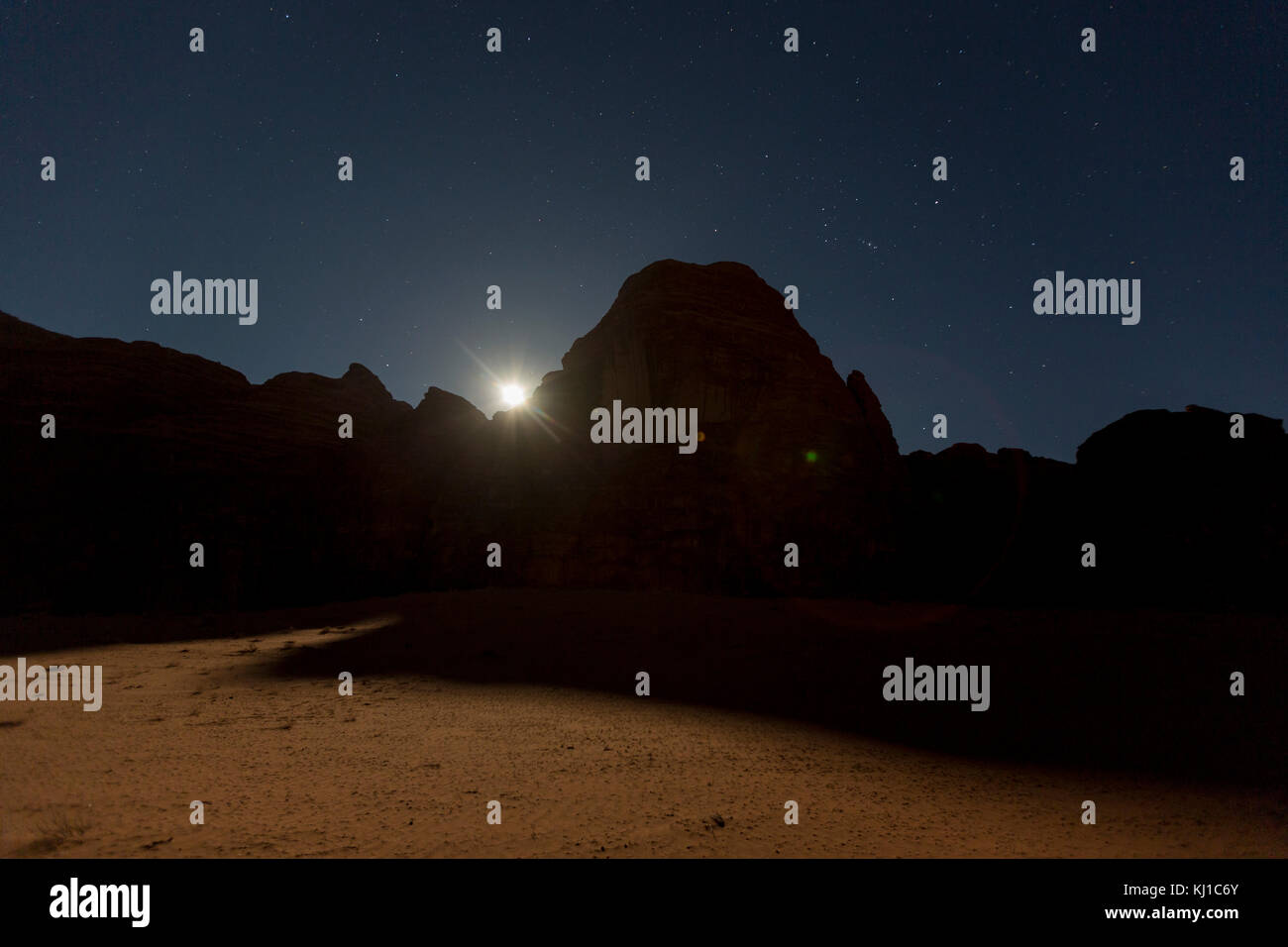 Wadi Rum at night during full moon, Jordan Stock Photo