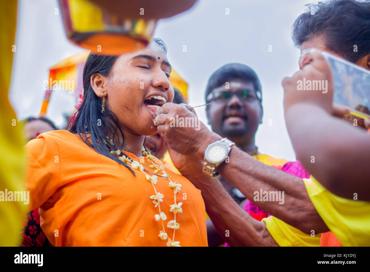 During Thaipusam festival in MAlaysia, Hindu Devotees preparing prayer blessing ceremony by piercing tounge to fulfill - Stock Image