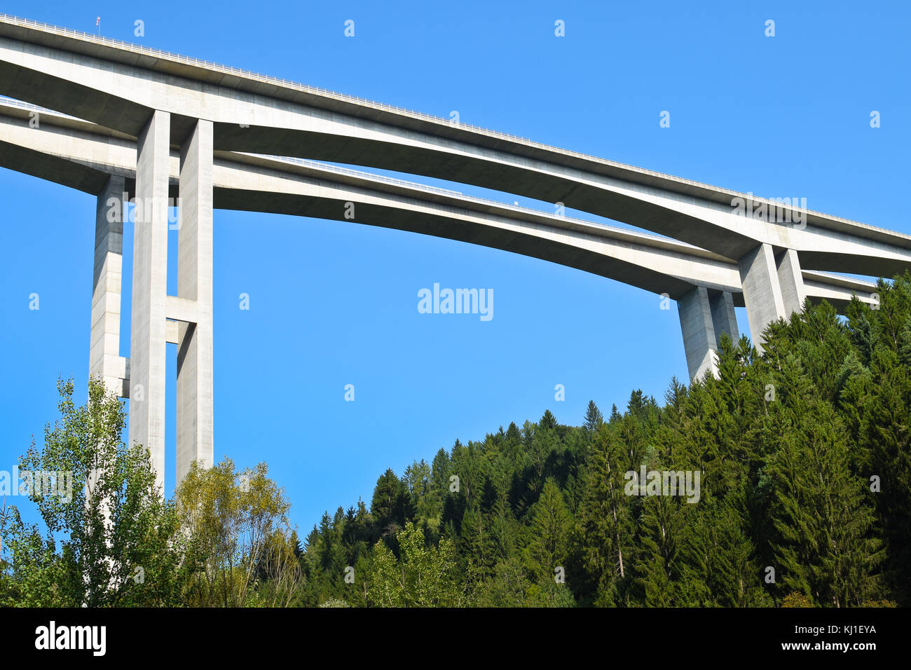 Detail of Highway Bridge from Bellow with Blue Sky - Stock Image
