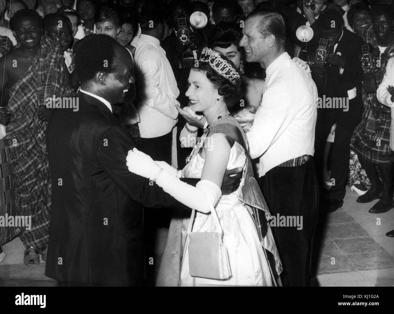 Queen Elizabeth II of Great Britain dances with President Kwame Nkrumah of Ghana, during her visit to Accra, Ghana, - Stock Image