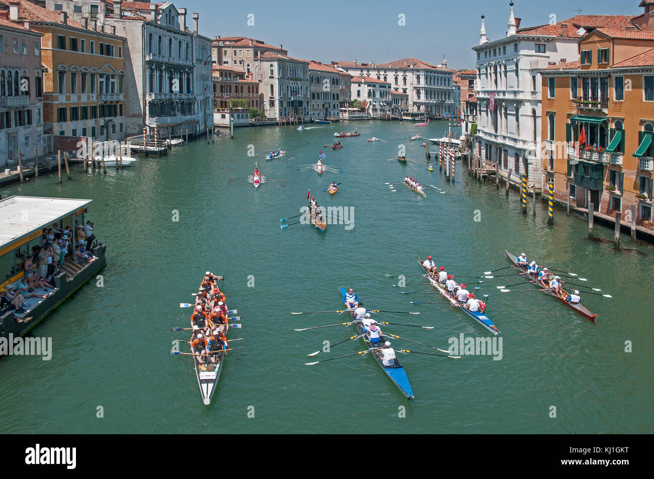 Rowing boats and canoes on the Grand Canal Venice Italy during Volga Lunga rowing festival seen looking north west Stock Photo