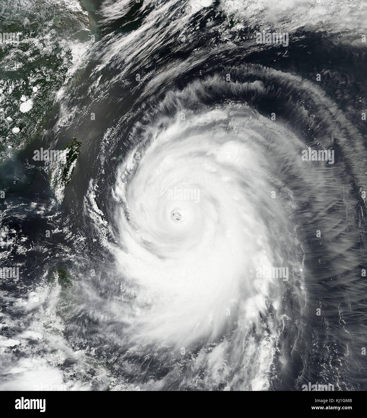 Typhoon Neoguri, known in the Philippines as Typhoon Florita, was a large and powerful tropical cyclone which mainly - Stock Image