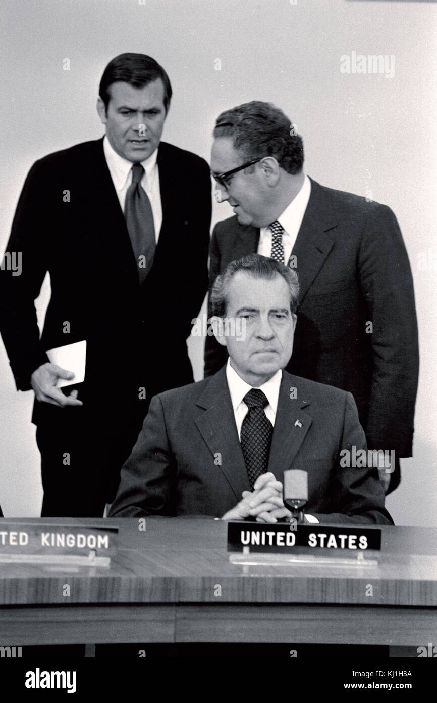 United States President Richard Nixon and Dr. Henry Kissinger, with Donald Rumsfeld at a 1974 NATO needing. - Stock Image