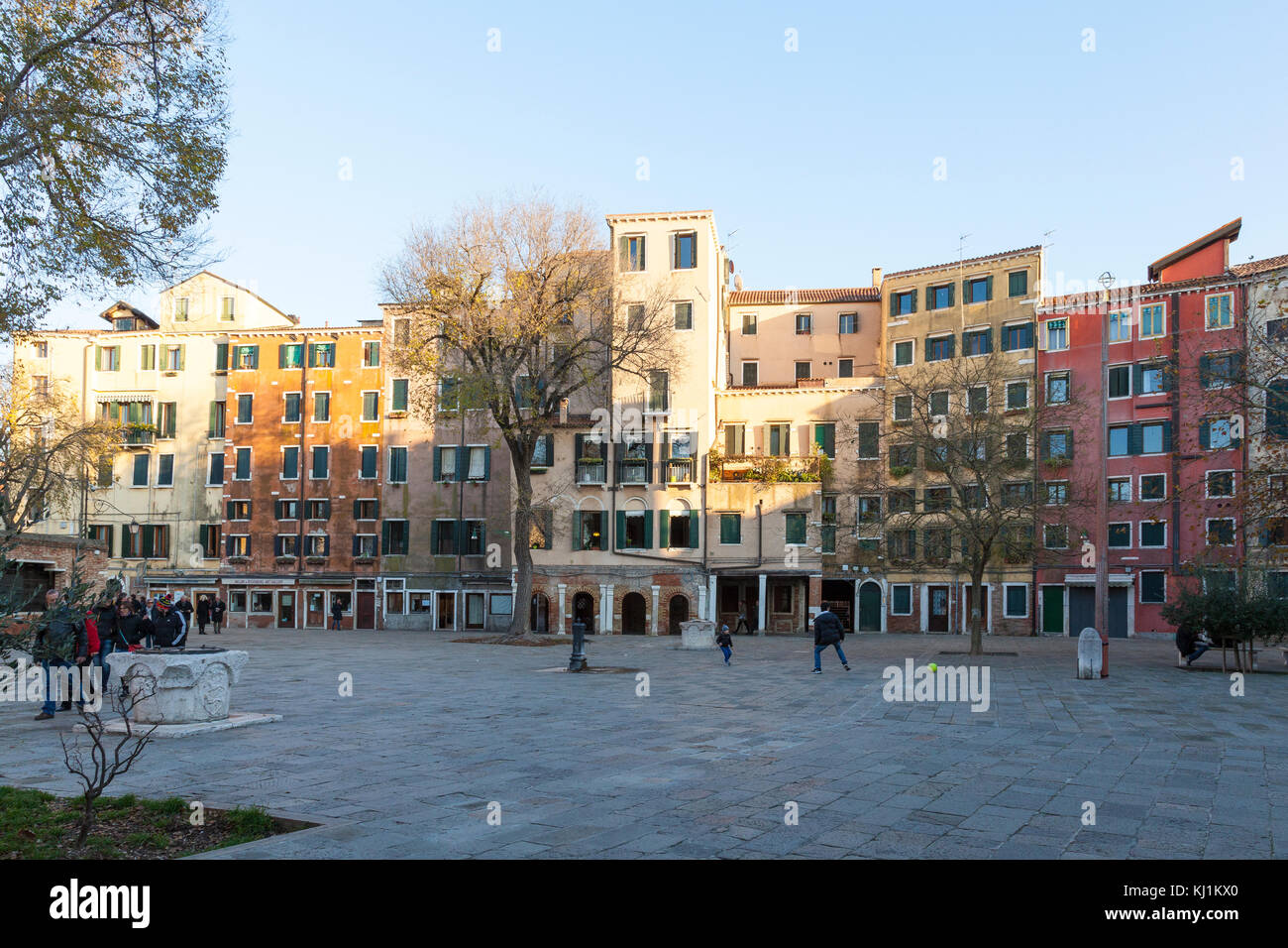 The Jewish ghetto, Campo de Ghetto Novo, at dusk, Venice, Veneto, Italy withits typical tall buildings due to lack - Stock Image