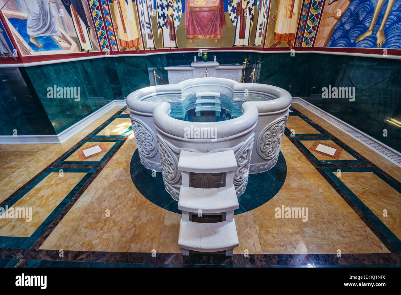 Large baptismal basin in Saint Jovan Vladimir Orthodox temple in Bar coastal town in southern Montenegro - Stock Image